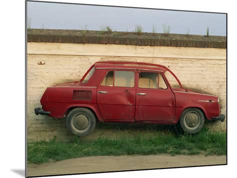 Half a Skoda on a Wall in a Car Salesyard Near Piestany, Slovakia, Europe-Strachan James-Mounted Photographic Print