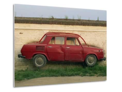 Half a Skoda on a Wall in a Car Salesyard Near Piestany, Slovakia, Europe-Strachan James-Metal Print