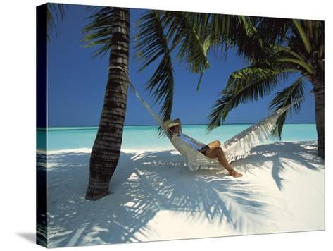 Man Relaxing on a Beachside Hammock, Maldives, Indian Ocean-Papadopoulos Sakis-Stretched Canvas Print