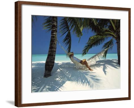 Man Relaxing on a Beachside Hammock, Maldives, Indian Ocean-Papadopoulos Sakis-Framed Art Print