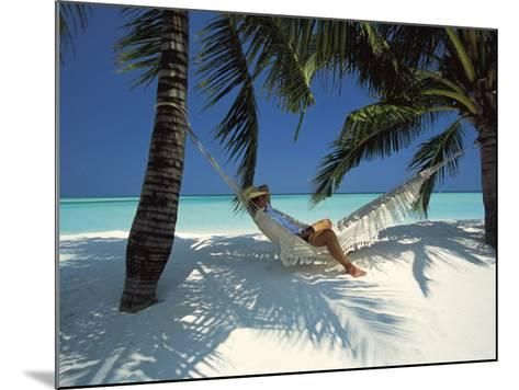 Man Relaxing on a Beachside Hammock, Maldives, Indian Ocean-Papadopoulos Sakis-Mounted Photographic Print