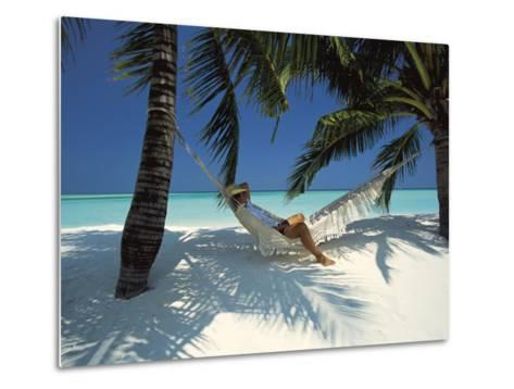 Man Relaxing on a Beachside Hammock, Maldives, Indian Ocean-Papadopoulos Sakis-Metal Print