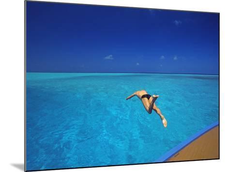 Man Jumping into Tropical Sea from Deck, Maldives, Indian Ocean-Papadopoulos Sakis-Mounted Photographic Print