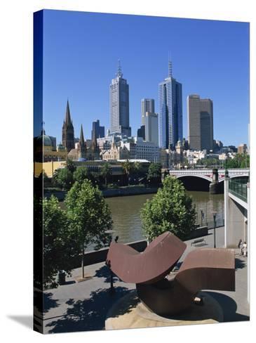 Sculpture on Yarra River Embankment and City Skyline, Melbourne, Victoria, Australia, Pacific-Hans Peter Merten-Stretched Canvas Print