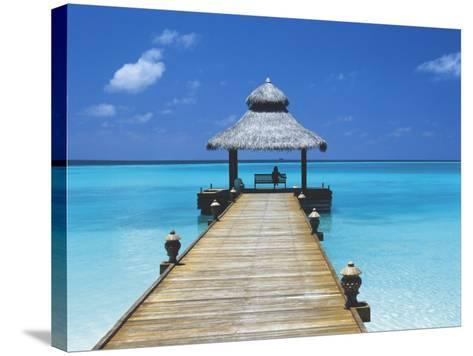 Young Woman Sitting on Bench at the End of Jetty, Maldives, Indian Ocean-Papadopoulos Sakis-Stretched Canvas Print