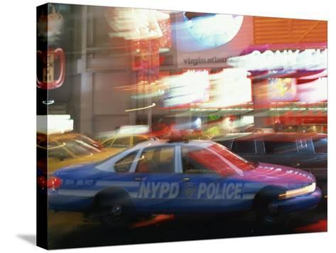 Nypd Police Car Speeding Through Times Square, New York City, New York, USA--Stretched Canvas Print