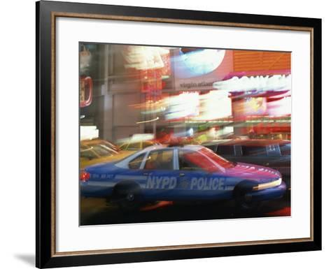 Nypd Police Car Speeding Through Times Square, New York City, New York, USA--Framed Art Print