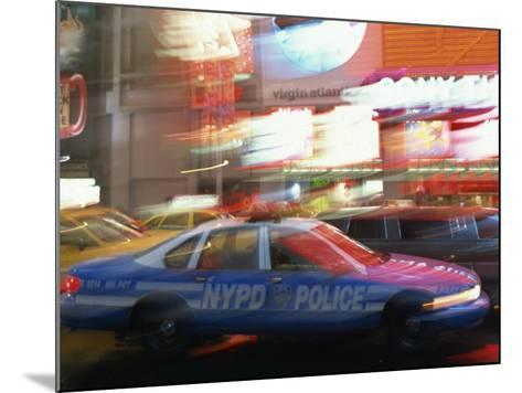Nypd Police Car Speeding Through Times Square, New York City, New York, USA--Mounted Photographic Print