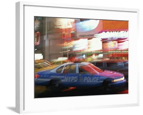 Nypd Police Car Speeding Through Times Square, New York City, New York, USA--Framed Art Print