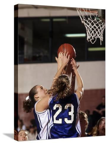 Female High School Basketball Players in Action During a Game--Stretched Canvas Print