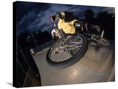 Bmx Cyclist Flys over the Vert--Stretched Canvas Print