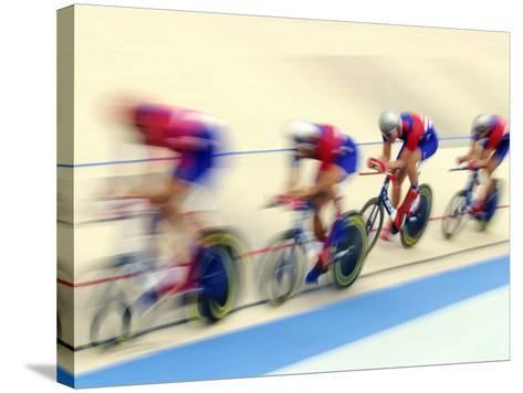 Blurred Action of Cycliing Team Onthe Track-Chris Trotman-Stretched Canvas Print