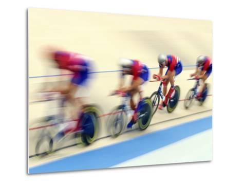 Blurred Action of Cycliing Team Onthe Track-Chris Trotman-Metal Print