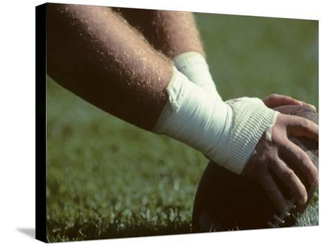 Football Center About to Snap the Ball-Paul Sutton-Stretched Canvas Print