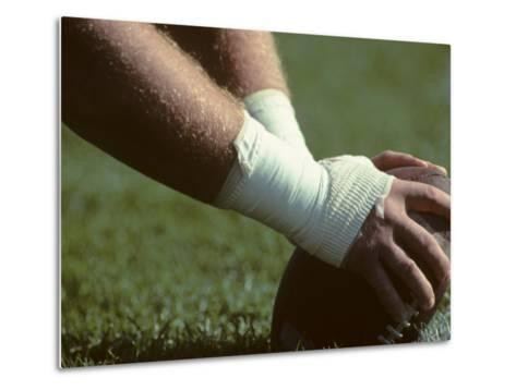 Football Center About to Snap the Ball-Paul Sutton-Metal Print