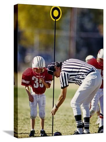 Referee Measuring for a First Down During a During a Pee Wee Football Game, Denver, Colorado, USA--Stretched Canvas Print