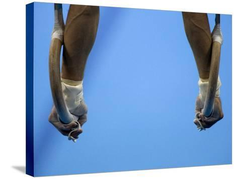 Male Gymnast Competing on Rings in Men's Qualification, 2004 Olympic Summer Games, Athens, Greece, -Steven Sutton-Stretched Canvas Print