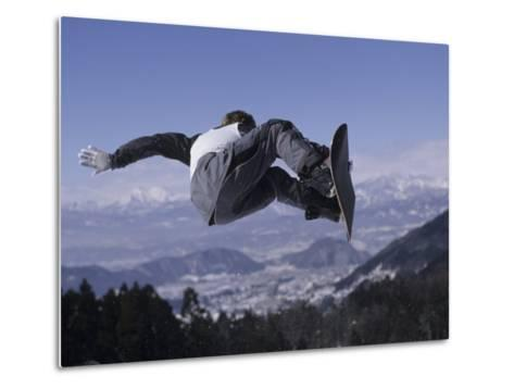 Male Snowboarder Flying over the Vert--Metal Print