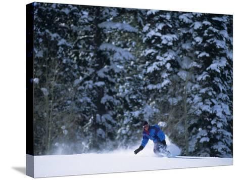 Male Snowboarder in Action--Stretched Canvas Print