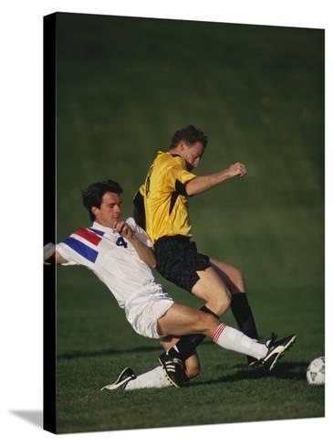 Soccer Players in Action--Stretched Canvas Print
