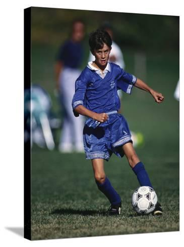 11 Year Old Boys Soccer Action--Stretched Canvas Print