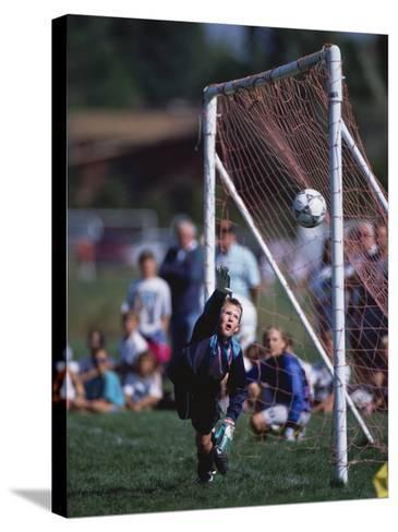 11 Year Old Boys Soccer Goalie in Action--Stretched Canvas Print
