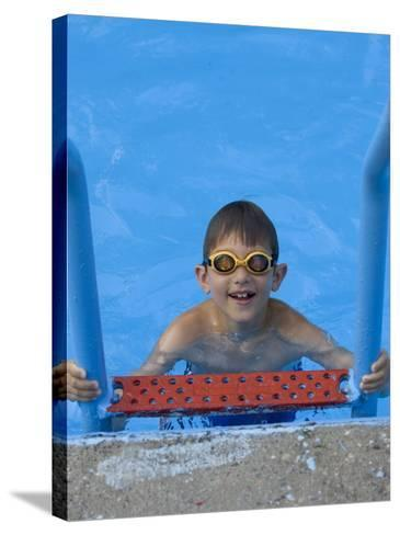 Portrait of 9 Year Old Boy in Swimming Pool, Kiamesha Lake, New York, USA-Paul Sutton-Stretched Canvas Print