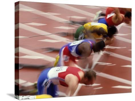 Start of a Mens 100M Race-Paul Sutton-Stretched Canvas Print