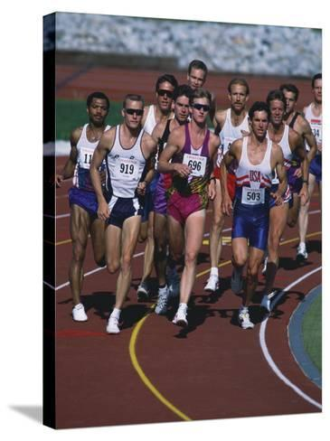 Male Runners Competing in a Track Race--Stretched Canvas Print