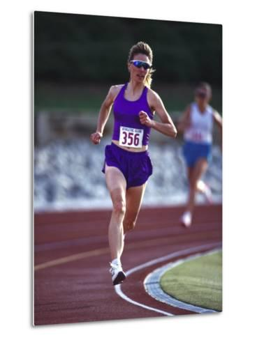 Female Runner Competing in a Track Race--Metal Print