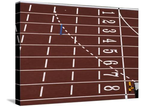 Track Lane Numbers at the Finish Line-Paul Sutton-Stretched Canvas Print