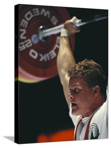Weightlifter in Action--Stretched Canvas Print
