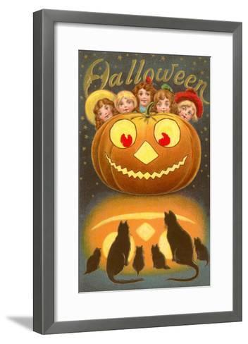 Halloween, Children behind Jack O'Lantern--Framed Art Print