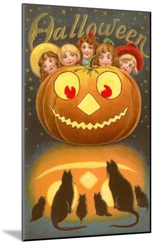 Halloween, Children behind Jack O'Lantern--Mounted Art Print