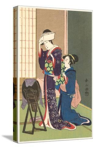 Geisha Being Dressed--Stretched Canvas Print