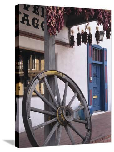 Antique wagon wheel, Old Town Albuquerque, New Mexico-Jerry Ginsberg-Stretched Canvas Print