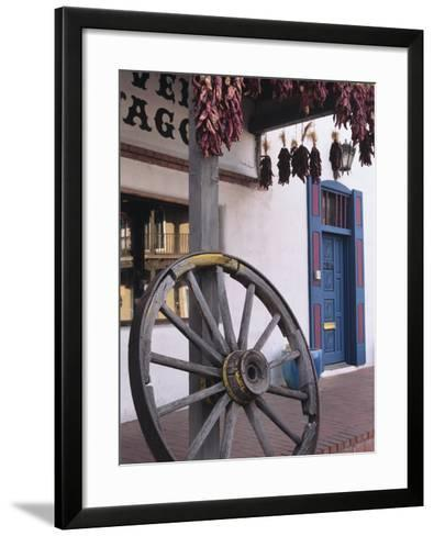 Antique wagon wheel, Old Town Albuquerque, New Mexico-Jerry Ginsberg-Framed Art Print