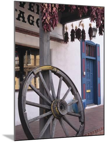 Antique wagon wheel, Old Town Albuquerque, New Mexico-Jerry Ginsberg-Mounted Photographic Print