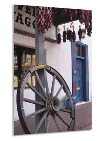 Antique wagon wheel, Old Town Albuquerque, New Mexico-Jerry Ginsberg-Metal Print