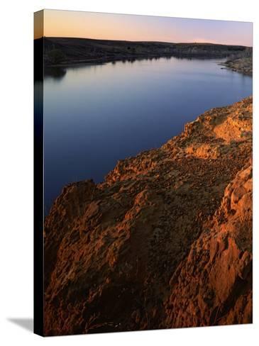 Sandstone bluff at sunset along Kanopolis Lake, Kanopolis State Park, Kansas, USA-Charles Gurche-Stretched Canvas Print