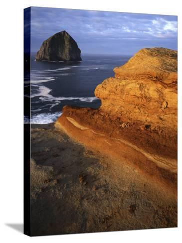 Rock formations along Oregon Coast at sunrise, Cape Kiwanda State Park , Oregon, USA-Charles Gurche-Stretched Canvas Print
