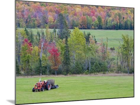 Tractor with Hay Bale, Bruce Crossing, Michigan, USA-Chuck Haney-Mounted Photographic Print