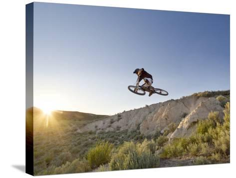Jumping the Clay Cliffs, Polson, Montana, USA-Chuck Haney-Stretched Canvas Print