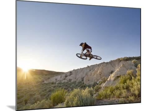 Jumping the Clay Cliffs, Polson, Montana, USA-Chuck Haney-Mounted Photographic Print