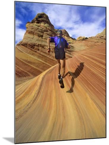 Trail Runner on Sandstone, Coyote Buttes, Utah, USA-Chuck Haney-Mounted Photographic Print