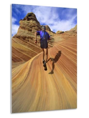 Trail Runner on Sandstone, Coyote Buttes, Utah, USA-Chuck Haney-Metal Print