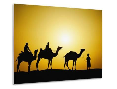 Camels and camel driver silhouetted at sunset, Thar Desert, Jodhpur, India-Adam Jones-Metal Print