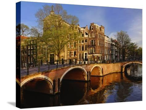 Canals at dusk, Amsterdam, Holland, Netherlands-Adam Jones-Stretched Canvas Print