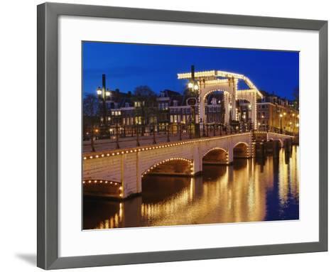 Dusk view of Magere Brug or Skinny Bridge and Amstel River, Netherlands, Holland-Adam Jones-Framed Art Print