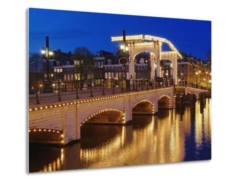 Dusk view of Magere Brug or Skinny Bridge and Amstel River, Netherlands, Holland-Adam Jones-Metal Print